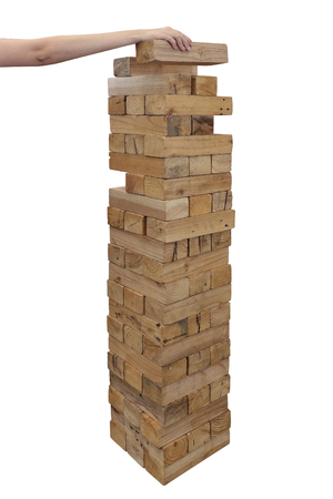 Foto de Hands playing large giant wooden tower game - Imagen libre de derechos