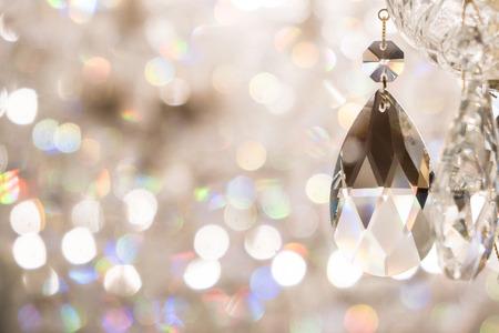 Foto de Close up image of crystal on chandelier with bokeh background - Imagen libre de derechos