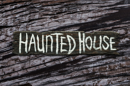 Old scary wooden haunted house board sign