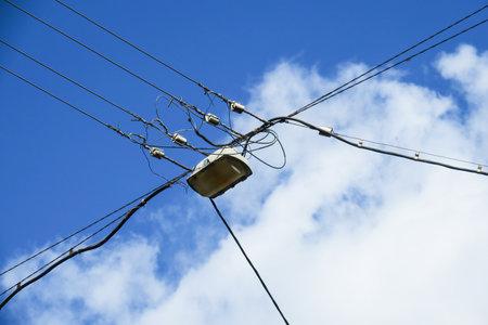 Photo pour Power lines and lamp on sky background - image libre de droit