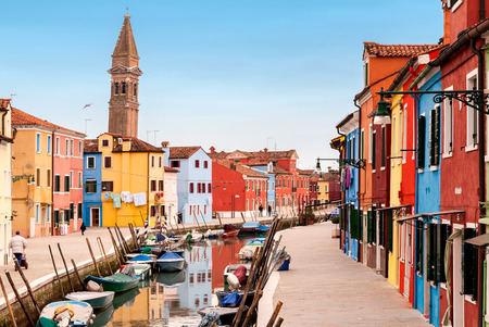 Venice landmark, Burano island canal, colorful houses and boats, Italy.