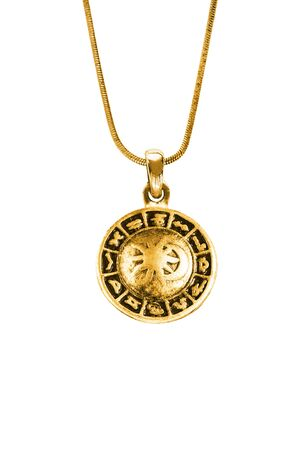 Photo for Vintage gold zodiac pendant hanging on a chain on white background - Royalty Free Image