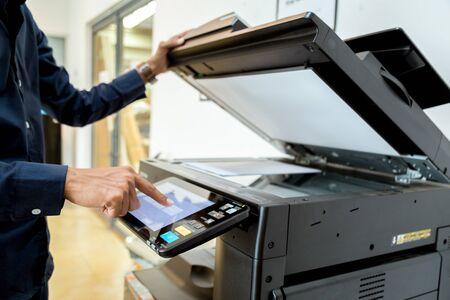Photo pour Bussiness man Hand press button on panel of printer, printer scanner laser office copy machine supplies start concept. - image libre de droit