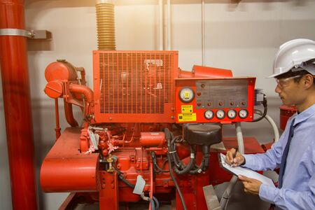 Photo pour diesel generator for fire control system red piping and valve. - image libre de droit