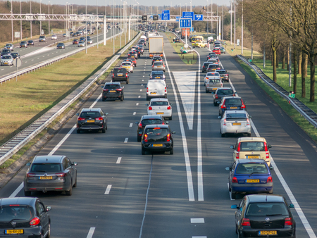 Foto de HILVERSUM, NETHERLANDS - APR 14, 2015: Traffic jam after accident during rush hour on motorway A1, Hilversum in the Netherlands - Imagen libre de derechos
