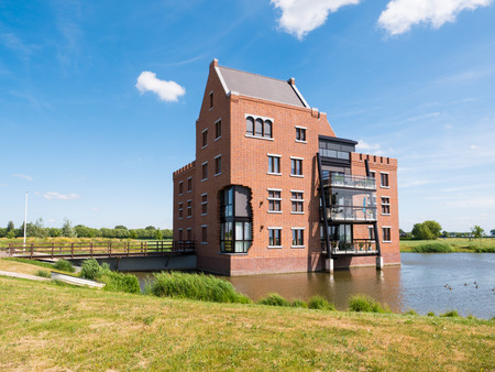 Modern waterfront apartment building in fortified town of Woudrichem, Brabant, Netherlands