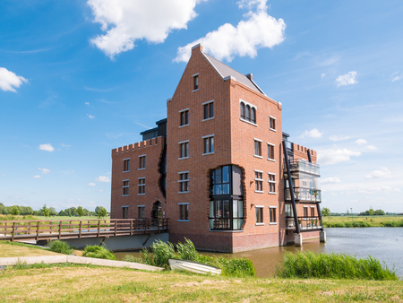 WOUDRICHEM, NETHERLANDS - JUN 4, 2017: Modern waterfront apartment building in fortified town of Woudrichem, Brabant, Netherlands