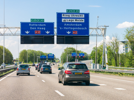 Traffic on motorway A12 and overhead route information signs, Oudenrijn, Utrecht,  Netherlands