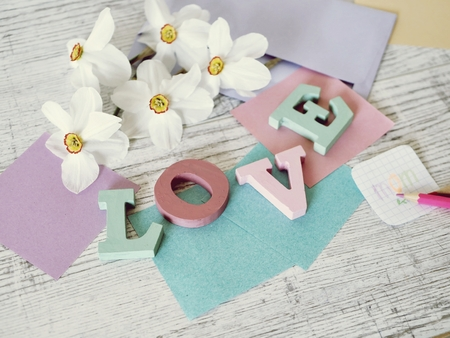 Photo for Mother's Day, congratulation, letters, decor, paper, pencils on the table, top view - Royalty Free Image
