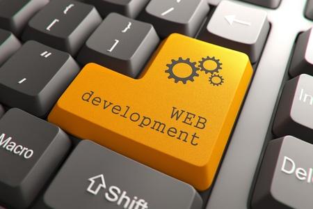 Orange Web Development Button on Computer Keyboard  Internet Concept