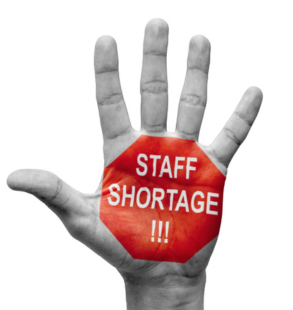 Staff Shortage - Raised Hand with Stop Sign on the Painted Palm - Isolated on White Background.