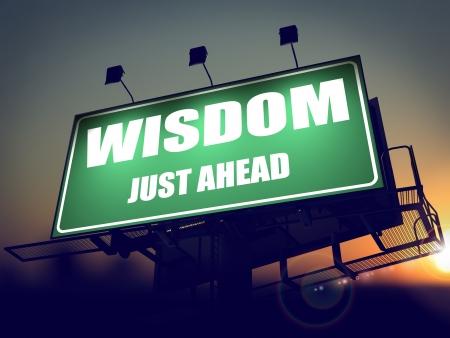 Wisdom Just Ahead - Green Billboard on the Rising Sun Background.