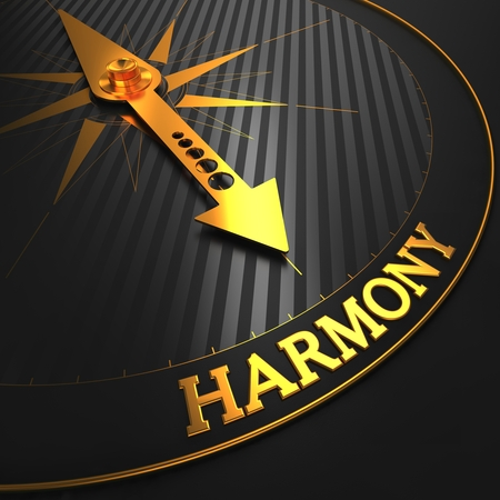 Harmony - Golden Compass Needle on a Black Field Pointing.