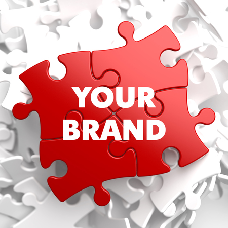Your Brand Concept on Red Puzzle on White Background.