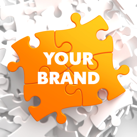 Your Brand on Orange Puzzle on White Background.