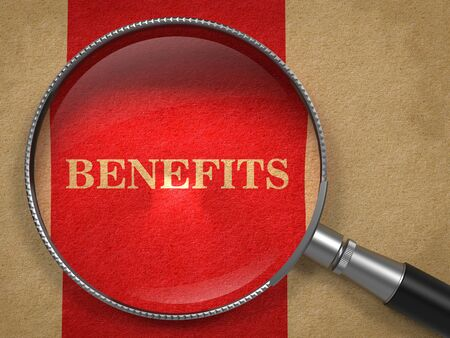 Benefits through Magnifying Glass on Old Paper with Red Vertical Line