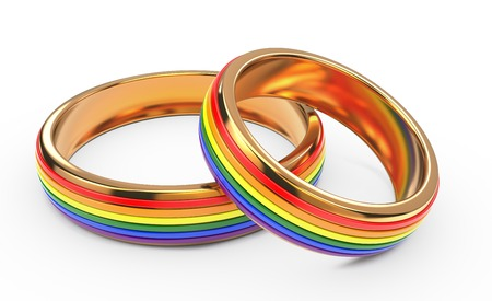 Foto de Gay Wedding Rainbow Rings Isolated on White Background. - Imagen libre de derechos