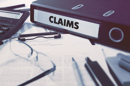 Photo for Claims - Ring Binder on Office Desktop with Office Supplies. - Royalty Free Image