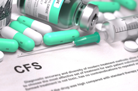 CFS - Chronic Fatigue Syndrome - Printed Diagnosis with Mint Green Pills, Injections and Syringe. Medical Concept with Selective Focus.