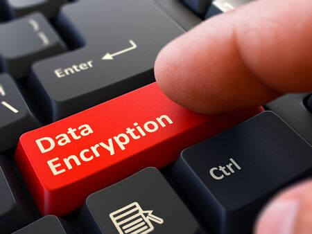 Photo pour Data Encryption Button. Male Finger Clicks on Red Button on Black Keyboard. Closeup View. Blurred Background. - image libre de droit