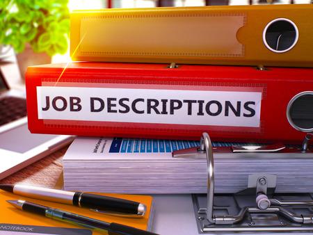 Photo pour Red Office Folder with Inscription Job Descriptions on Office Desktop with Office Supplies and Modern Laptop. Job Descriptions Business Concept on Blurred Background. 3D Render. - image libre de droit