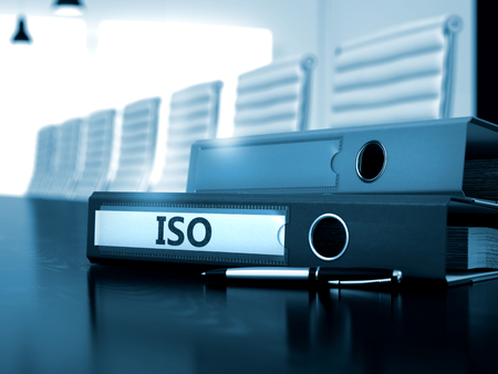 ISO - Business Concept on Blurred Background. ISO - File Folder on Office Wooden Desktop. ISO - Concept. 3D.