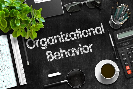 Photo pour Organizational Behavior. Business Concept Handwritten on Black Chalkboard. Top View Composition with Chalkboard and Office Supplies. 3d Rendering. - image libre de droit