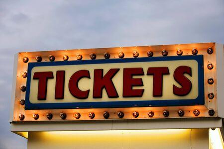 Ticket booth sign illuminated at twilight