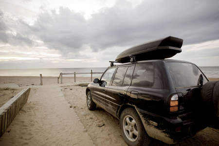 Car at Inverness beach, Cape Breton, Nova Scotia