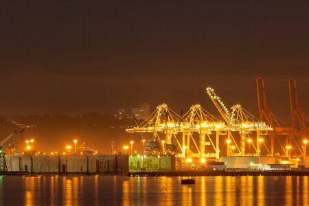 Photo for Cranes at Port of Seattle terminal at night, Washington, USA - Royalty Free Image