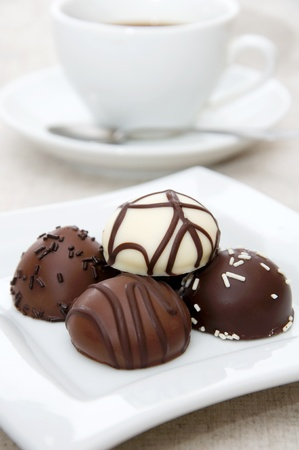 Some chocolate candies on white plate