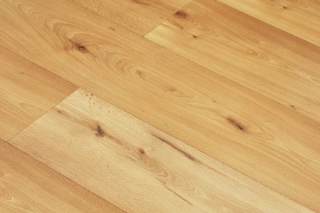 image of wood or wooden laminate floor boards close up