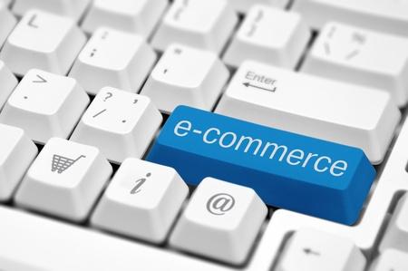 e-commerce key on a white keyboard closeup  E-commerce concept image