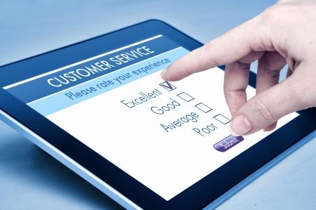 Online customer service satisfaction survey on a digital tablet