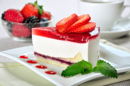 Photo pour piece of strawberry cheesecake on white plate with coffee cup - image libre de droit