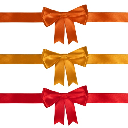 Set of ribbon bows - red, yellow, orange on white background. Clipping path for each bow included.