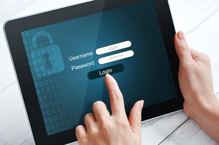Photo pour Female hands using tablet pc protected with password - image libre de droit