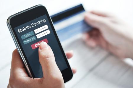 Photo pour Female hands using mobile banking on smart phone - image libre de droit