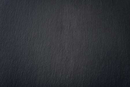 Black slate texture closeup. May be used as background