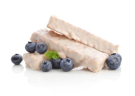 Yogurt Muesli Bars with fresh blueberry isolated on white background