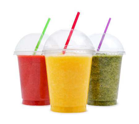 Photo pour Green, orange and red smoothie in plastic transparent cups isolated on white background - image libre de droit