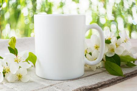 Photo pour Mug mockup with apple blossom. Mug mockup. Coffee cup template. Coffee mug template. Mug template. Mug design template. Mug design. Mug printing design. White mug mockup. Cup mockup. Blank mug. - image libre de droit
