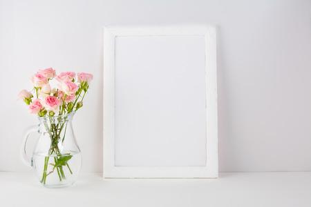 Frame mockup with pink roses. Frame mockup. White frame mockup. Poster Mockup. Styled mockup. Product mockup.  Design Mockup. Empty frame mockup. Portrait frame mockup.