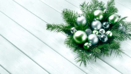 Foto de Christmas decorations with silver and green ornaments. Christmas party decoration with shiny balls. Christmas greeting background. Copy space. - Imagen libre de derechos