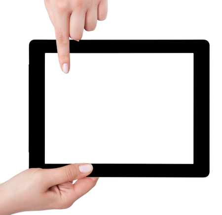 Hand holding a tablet computer with white screen. Woman hands showing empty screen of modern digital tablet. Hand holding tablet pc isolated on white background with blank screen.