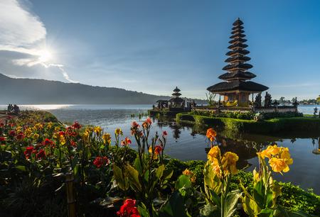 flowers Pura Ulun Danu temple on a lake Beratan, Bali, Indonesia, HDR style