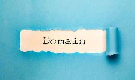 Photo pour domain  word on torn  paper - image libre de droit