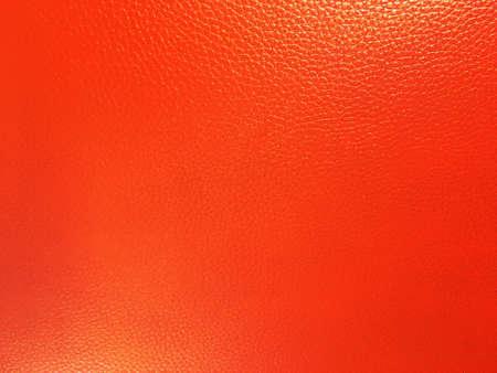 Photo pour Bright orange leather background closeup. - image libre de droit
