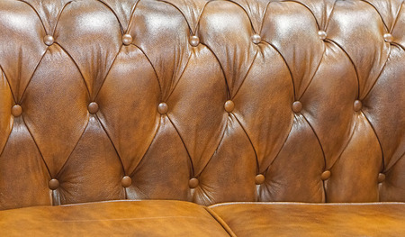 Brown leather sofa backrest upholstery pattern