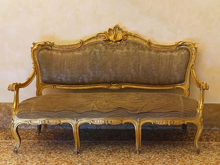Classic style golden sofa with patina
